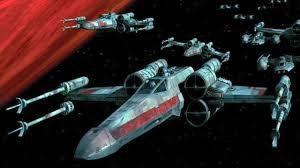 Tres naves de la alianza volando en el espacio alrededor de un planeta, de la película Rogue One