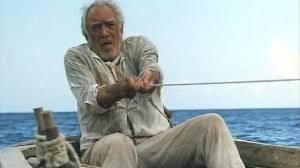 Anthony Quinn interpretando a Santiago en una versión cinematográfica de El viejo y el mar